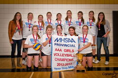 The Linden Christian Wings celebrate their varsity girls AAA provincial volleyball championship. The Wings defeated Westgate Mennonite Collegiate for the first time in seven tries in the final.