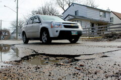 Munroe Avenue and London Street have been plagued with potholes this spring.