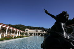 A replica depicting a drunken faun overlooks the garden pool at the Getty Villa in Los Angeles.