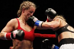 Olivia Gerula (left)  takes a left in the mouth from Jaime Ward during the Peg City Massacre at the Winnipeg Convention Centre Saturday night. Gerula won the bout in a six-round decision.