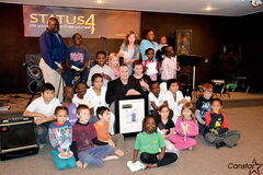 When they found out Winnipeg Police Service Constable and Status4 Inc. president Kevin Gibson (seated in centre) was named Winnipeg's Top Cop by Kiwanis Club of Winnipeg, the kids who take classes at the Elmwood non-profit made him a special plaque to commemorate the occasion.