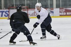 Winnipeg Jets' Jim Slater (right) stick handles past Jets' Tobias Enstrom during practice Thursday morning at the MTS Iceplex. The Jets, and the rest of the NHL, will be off the ice until Jan. 14, the NHL announced Thursday.