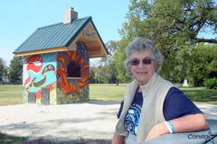 Elaine Bishop, executive director of the North Point Douglas Women's Centre, in front of the community oven in scenic Michaelle Jean Park.