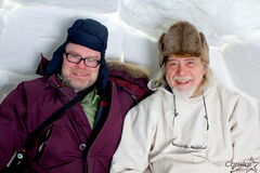Manitoba Urban Inuit Association executive director Christian Cassidy (left) and board member Fred Ford escape the elements in one of the two igloos Ford built as part of the Creation & Transformation Inuit art exhibit on display at the Winnipeg Art Gallery until April 14.