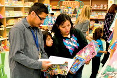 Dufferin parent Rick Boucher (left) along with his wife and daughter shop for books at Chapters Polo Park on Oct. 19.