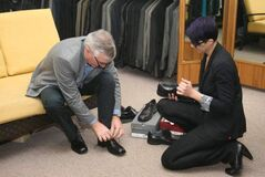 Manitoba's Finance Minister Stan Struthers buys some new shoes at Gardner's Lifestyle Fashions in his hometown of Dauphin.