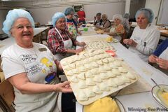 Doris Skakun, left, with the perogy-making crew at St. Ivan Suchavsy Cathedral on Main Street.
