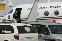 Mexican officials leave a Mexican presidential plane at James Richardson International Airport in Winnipeg Saturday. The Mexican plane was flown to Winnipeg to drop off samples of the H1N1 flu to be tested in at the National Microbiology Lab in Winnipeg.