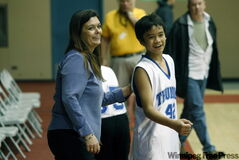 Tyndall Park coach Sandra Ducharme shares a laugh with Daniel Tuazon.
