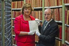 Cabinet Secretary for Culture and External Affairs Fiona Hyslop with Mr George MacKenzie, Keeper of the Records of Scotland with the documents.