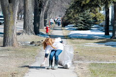 Isaac Brock student Alexa Winkler was leading a pack of bag-toating cleaners along Clifton Street last week as part of West End Biz' annual Sweep Off neighbourhood clean up.