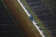 A vehicle is seen washed off of Highway 83 south of Highway 2 as floodwaters cover the highway on June 26, 2013. June and July brought a series of powerful storms to Westman. Areas including Pipestone, Reston and Virden received the brunt of the damage.