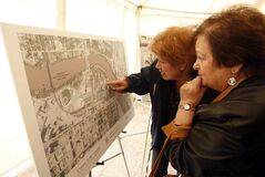 Susan Schmidt  and Joyce Gittins look over plans for the future heritage park at the site of Upper Fort Garry.