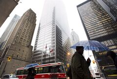 People walk in Toronto's financial district on Oct. 29, 2012. THE CANADIAN PRESS/Nathan Denette