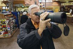 Joe Bryksa / Winnipeg Free Press Ed Rekkedal shops at Cabela's in East Grand Forks. He voted based on his desire to protect the right to bear arms.