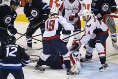 Winnipeg Jets and Washington Capitals players scramble for the puck in front of Washington Capitals' goaltender Braden Holtby in the third period of Saturday's game.