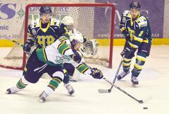 The Terriers'Riley Hay readies a backhand against the Humboldt Broncos as Humboldt's Ryan Marshall (left) and Kameron Ballas watch for a blocking chance.
