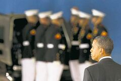 President Barack Obama watches while transfer cases are placed into hearses during the Transfer of Remains Ceremony marking the return to the United States of the remains of the four Americans killed this week in Benghazi, Libya, at Joint Base Andrews, Friday, September 14, 2012.