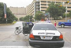 Police secure intersection on University of Texas campus.