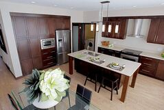 Kitchen highlights include custom-stained maple cabinets, Caesarstone countertops and a high-end laminate floor.