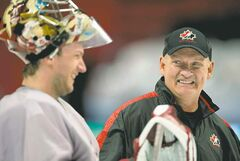 Team Canada head coach Lindy Ruff (right) has a roster that includes  Coyotes goalie Mike Smith.