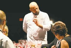 Chef Eric Lee presents his entry to the judging panel.