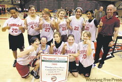 The North Kildonan Cobras show their championship banner in the Winnipeg Free Press Classic 11-12 girls� event, with coach Karl Schroeder.