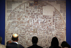 The medieval mappa mundi, the Ebstorf world map (shown in a photographic reconstruction), shows the world as the body of Christ with his arms and feet emerging from the map.