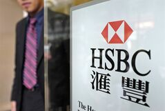 A man walks out from an HSBC branch office in Hong Kong, May 7, 2014. THE CANADIAN PRESS/AP, Vincent Yu