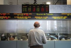 A man watches the financial numbers on the digital ticker tape at the TMX Group in Toronto's financial district on May 9, 2014. THE CANADIAN PRESS/Darren Calabrese