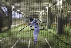 Minnesota Twins' Eduardo Escobar takes swings in the batting cage during a rain delay in a spring training baseball game against the Minnesota Twins in Fort Myers, Fla., Wednesday, March 20, 2013. (AP Photo/Elise Amendola)
