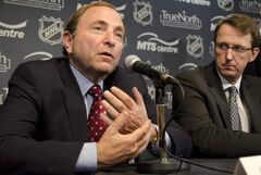 Gary Bettman announces the return of the NHL to Winnipeg on May 31, 2011, as True North's Mark Chipman looks on.