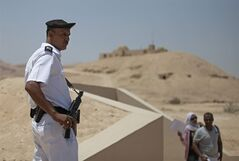 A policeman stands guard during the opening of an exact replica of the Tomb of Tutkankhamun in Luxor , Egypt. Wednesday, April 30, 2014. The replica aims�to help preserve the original, more than 3,300-year-old tomb from deterioration caused by tourist visitors. (AP Photo/Khalil Hamra)