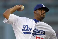 Sweat flies off of Los Angeles Dodgers starting pitcher Roberto Hernandez as he throws to the plate during the first inning of a baseball game against the San Diego Padres, Wednesday, Aug. 20, 2014, in Los Angeles. (AP Photo/Mark J. Terrill)