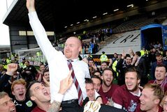 FILE - This is a April 21 2014 file photo of Burnley's manager Sean Dyche celebrates after his side win promotion to the English Premier League during their championship match at Turf Moor, Burnley England. The new English Premier League season starts on Saturday Aug. 16, 2014. (AP Photo/Clint Hughes/PA, File) UNITED KINGDOM OUT NO SALES NO ARCHIVE