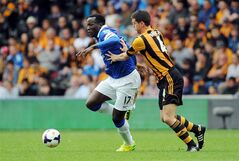 Everton's Romelu Lukaku, left, and Hull City's Alex Bruce in action during the English Premier League soccer match at KC Stadium, Hull, England, Sunday May 11, 2014. (AP Photo/PA, Anna Gowthorpe) UNITED KINGDOM OUT NO SALES NO ARCHIVE