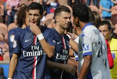 Paris Saint Germain's Thiago Motta, center and Bastia's Brandao, right, greets each other prior to the kick-off of a French League One soccer Match Paris Saint Germain against Bastia, while Argentinian Javier Pastore,left, stands next to them, at Parc des Princes stadium, in Paris, Saturday, Aug. 16. 2014. Paris Saint-Germain President Nasser Al-Khelaifi wants Brandao to be banned for life after the Bastia striker headbutted Thiago Motta at the end of a French league match on Saturday. After Bastia's 2-0 loss to PSG, Brandao waited for Thiago Motta in the tunnel and headbutted the midfielder, leaving him with blood running down from his nose. Al-Khelaifi said the Italian had a broken nose, although the club had not disclosed any injury details. (AP Photo/Michel Euler)