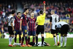 Referee shows a red card to FC Barcelona's Jordi Alba, second left, against Valencia during a Spanish La Liga soccer match at the Camp Nou stadium in Barcelona, Spain, Saturday, Feb. 1, 2014. (AP Photo/Manu Fernandez)