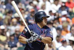 Minnesota Twins designated hitter Kendrys Morales hits a one-run single against the Detroit Tigers in the sixth inning of a baseball game in Detroit, Sunday, June 15, 2014. (AP Photo/Paul Sancya)