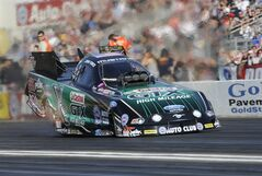 In this photo provided by the NHRA, John Force races during qualifying position in Funny Car at the NHRA Winternationals drag races at Auto Club Raceway on Saturday, Feb. 8, 2014, in Pomona, Calif. His time from Friday night stood up for the rest of qualifications. (AP Photo/NHRA, Jerry Foss)