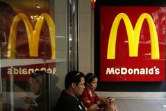 "FILE - In this July 25, 2014 file photo, customers sit at a McDonald's restaurant in Hong Kong. McDonald's says a scandal over a meat supplier in China is hurting sales in the region and its global sales forecast for 2014 is ""at risk."" The world's biggest hamburger chain said in a regulatory filing Monday, Aug. 4, 2014, that there's been ""significant negative impact"" in China, Japan and other affected market. (AP Photo/Kin Cheung, File)"