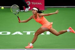 China's Peng Shuai returns the ball during a match against Russia's Nadia Petrova on the first day of the WTA Qatar Ladies Open in Doha, Qatar, Monday, Feb. 10, 2014. (AP Photo/Osama Faisal)