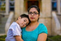 Belhen Rojo stands with her son Jacob, 4, in front of Laura Secord School in Wolseley.