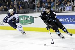San Jose Sharks' Marc-Edouard Vlasic (44) is chased by Winnipeg Jets' James Wright (17) during the second period of an NHL hockey game on Thursday, Jan. 23, 2014, in San Jose, Calif. (AP Photo/Marcio Jose Sanchez)