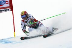 Austria's Marcel Hirscher speeds down the course during the first run of an alpine ski men's World Cup giant slalom in St. Moritz, , Switzerland, Sunday, Feb. 2, 2014. (AP Photo/Pier Marco Tacca)