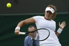 Maria-Teresa Torro-Flor of Spain plays a return to Venus Williams of the U.S. during their first round match at the All England Lawn Tennis Championships in Wimbledon, London, Monday, June 23, 2014. (AP Photo/Sang Tan)