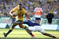 Australia's Sekope Kepu, left, fends off France's Wesley Fofana during their rugby union test match in Sydney, Saturday, June 21, 2014. (AP Photo/Rick Rycroft)
