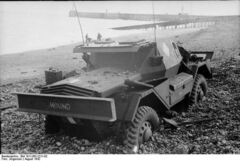 British Daimler Scout Car 'Hound' abandoned on the beach after the raid on Dieppe.