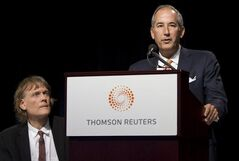 Thomson Reuters CEO Thomas Glocer, right, speaks as Chairman David Thomson looks on in Toronto, May 3, 2011. Glocer is stepping down as CEO of Thomson Reuters Corp. after a decade-long run as boss of the embattled global data and news giant controlled by Canada's Thomson family. THE CANADIAN PRESS/Darren Calabrese