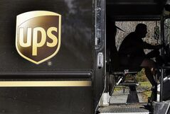 In this Oct. 22, 2012 photo, a UPS driver drives after a delivery in North Andover, Mass. THE CANADIAN PRESS/AP, Elise Amendola